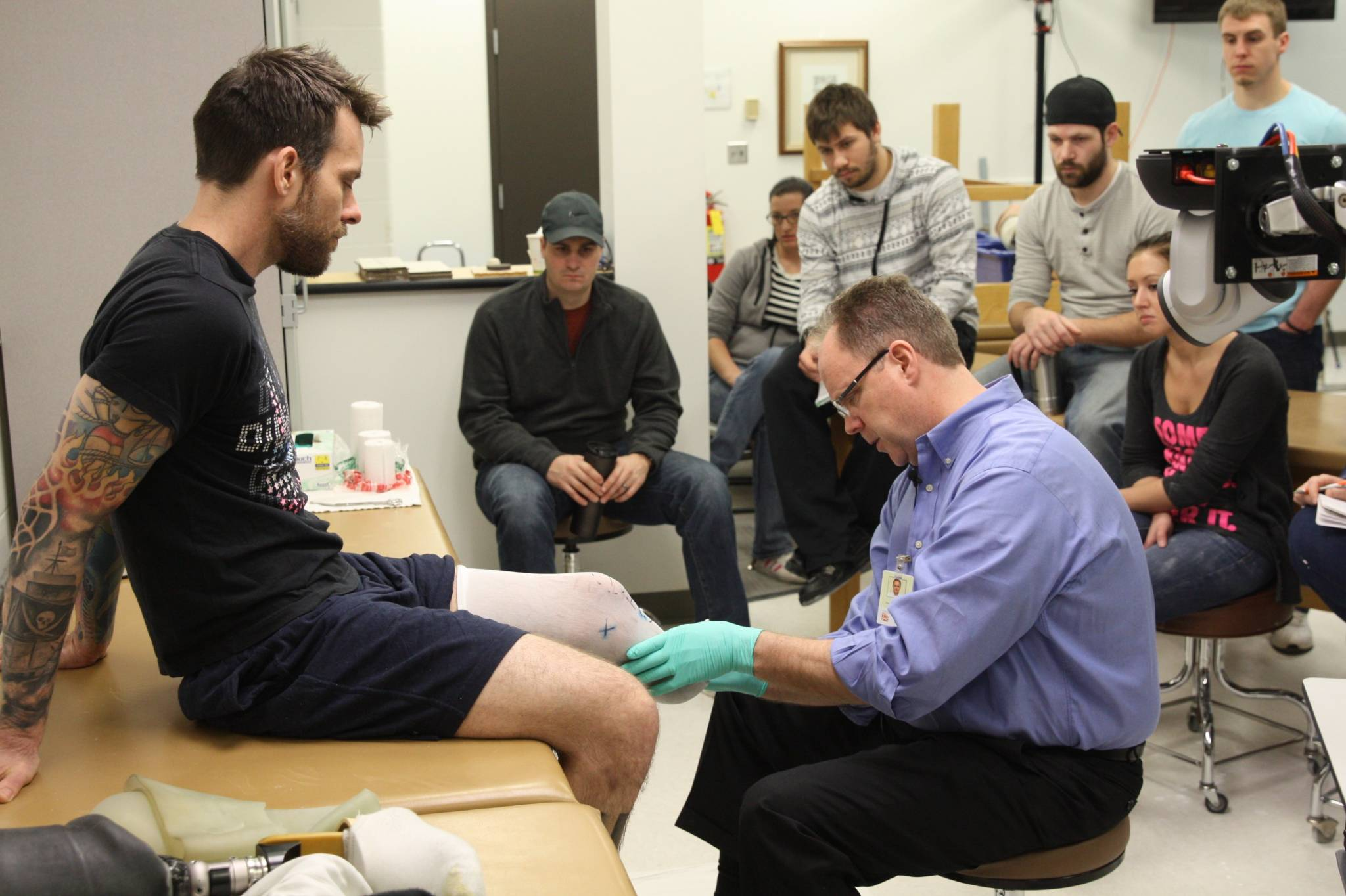 Century College Instructor Roger Wagner makes a leg prothesis mold